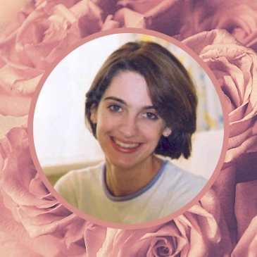 A portrait shot of Emily Collingridge, smiling at the camera. The image is on a background of pink roses